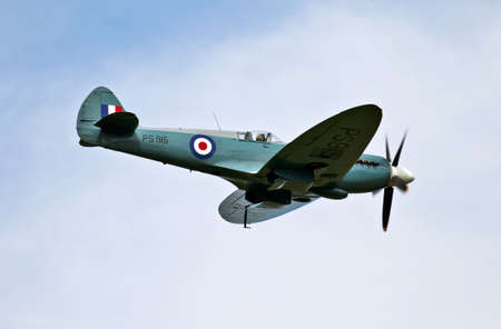 HEADCORN, UK - AUGUST 11, 2012: A Spitfire from the BBMF gives a display at the combined ops show to the public