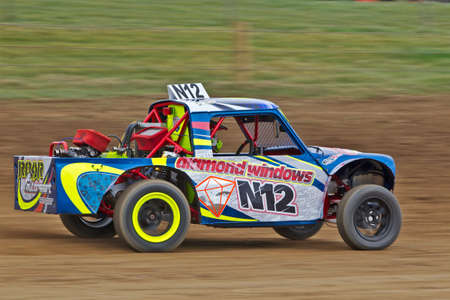 unnamed: DARLEY MOOR, UK - APRIL 14: An unnamed driver takes his autograss class6 mini pickup around the Pennine circuit at speed during the UK national qualifiers on April 14, 2013 in Darley Moor Editorial