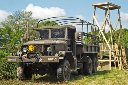 DENMEAD, UK - MAY 25: An ex WW2 US Army GS REO truck is placed on static display under a makeshift observation tower at the Overlord Military show on May 25, 2013 in Denmead