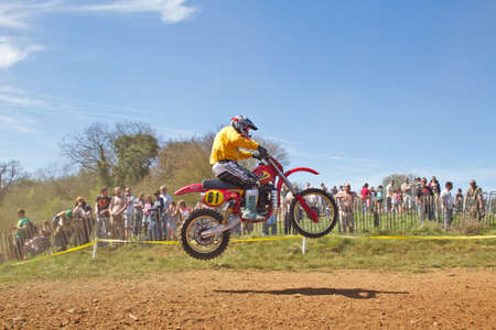 acu: ASHAM WOOD, UK - MAY 6: An unnamed solo MX rider competing in the ACU Vets championship leaps out of the dust bowl at speed on May 6, 2013 in Asham Wood