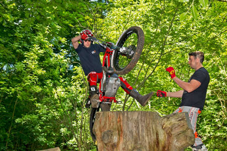 unnamed: CHALFONT, UK - JUNE 2: An unnamed rider attempts to jump a 5 foot high tree stump on his trials motorcycle during the Berko MCC Tough Ten trial on June 2, 2013 in Chalfont Editorial