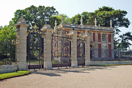 gatehouse: WADDESTON, UK - JUNE 6: Rear gate & gatehouse of Waddeston manor on June 6, 2013 in Waddeston. The entire ornate rear gate and entrance were renovated to celebrate the diamond jubilee of QEII in 2012 Editorial
