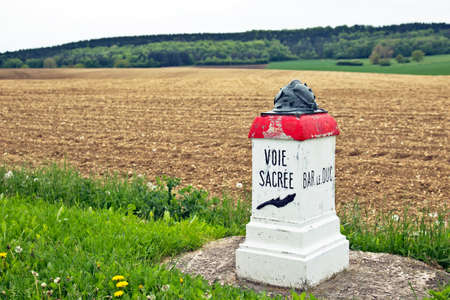demarcation: VERDUN, FRANCE - MAY 18: A commemoration stone to the sacrifice made by the Polius along the Voie de Sacre during the battle of Verdun in 1916 sits alongside the new road on May 18, 2013 in Verdun.