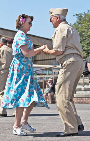 jive: WESTERNHANGER, UK - AUGUST 18 Two dancers in 1940 s costume give an impromptu performance of the Jive to passers by at the War   peace show on August 18, 2013 in Westernhanger Editorial