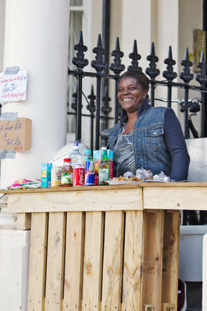 kerb: LONDON - AUGUST 25  An impromptu street stall is setup on the kerb to sell a variety of Afro Carribean meals to the public attending the Notting Hill Carnival on August 25, 2013 in London