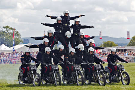 WEEDON, UK - AUGUST 29  Members of the Royal Signals White Helmets display team demonstrate their Pyramid formation for the public at the Bucks County show on August 29, 2013 in Weedon Editorial