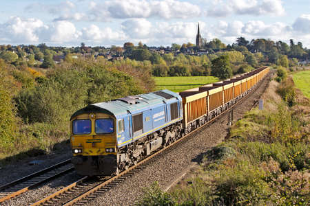aggregates: KINGS SUTTON, UK - OCTOBER 23  A Bardon Aggregates stone train passes Banbury bank on October 23, 2013 in Kings Sutton  The company was originally founded in 1858 before being bought by Holcim in 2005  Editorial