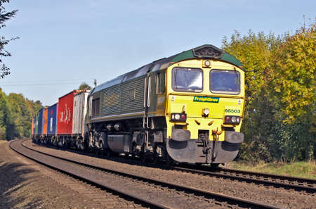 intermodal: CROPREDY, UK - OCTOBER 24  An intermodal freight train works its way to the south coast from Manchester on October 24, 2013 in Cropredy  In 2011 12 rail transported 101 Mn tons valued at over �30 Bn
