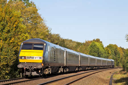 power operated: BANBURY, UK - OCTOBER 24  Chiltern Railways operated express The Businessman, passes Cropredy crossing on October 24, 2013 in Banbury  Chiltern operate a fleet of 87 power units calling at 62 stations