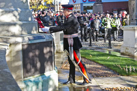 lieutenant: AYLESBURY, UK - NOVEMBER 10  The Lord Lieutenant of Buckinghamshire places a memorial wreath to the fallen members of the UK armed forces on November 10, 2013 in Aylesbury