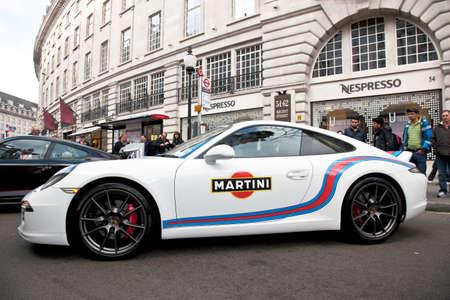 regent: LONDON - NOVEMBER 2  A Porsche 911 sports car maneuvers into position along Regent Street at the beginning of the annual Regent Street motor show on November 2, 2013 in London