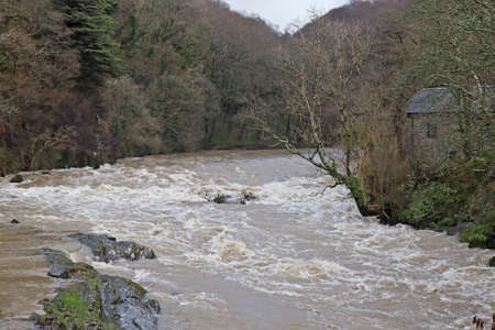 CENARTH, UK - DECEMBER 30  Flood waters threaten the surrounding roads and housing as the Afon Teifi river bursts its banks during a sustained period of heavy rainfall on December 30,2013 in Cenarth