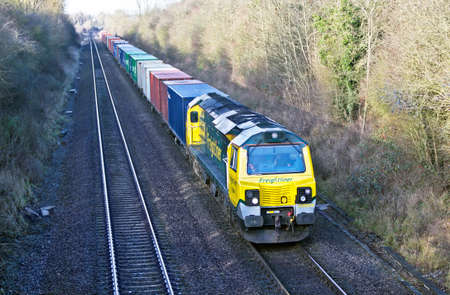 valued: KNIGHTCOTE, UK - DECEMBER 19  A class 70 intermodal freight train travels south en route to Banbury on December 19, 2013 in Knightcote  In 2011 12 rail transported 101Mn tons valued at over �30Bn Editorial