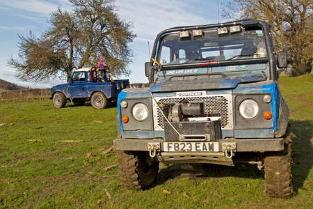 rovers: GREAT MALVERN, UK - DECEMBER 8  Land Rovers belonging to MROC owners leave their vehicles at the start of stage 2 of the Croft Farm off road trial competition on December 8, 2013 in Great Malvern