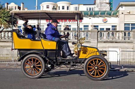 london to brighton: BRIGHTON, UK - NOVEMBER 4  A vintage motorcar passes along Madeira Drive toward the finish line having just completed the annual London to Brighton vintage car race on November 4, 2012 in Brighton