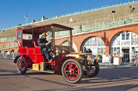 london to brighton: BRIGHTON, UK - NOVEMBER 4  A vintage 1904 Darracq motorcar passes along Madeira Drive having successfully completed the annual London to Brighton vintage car race on November 4, 2012 in Brighton