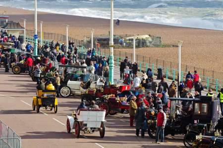 london to brighton: BRIGHTON, UK - NOVEMBER 4  Motorcar owners and members of the public mingle along Brighton seafront having completed the annual London to Brighton veterans car rally on November 4, 2012 in Brighton   Editorial
