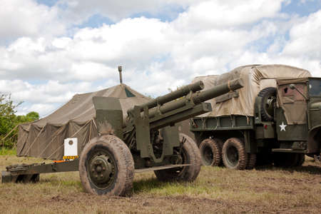 artillery shell: DENMEAD, UK - MAY 25  A WW2 allied artillery field gun is put on public display alongside a WW2 period US General Service truck as part of the Overlord show experience on May 25, 2014 in Denmead  Editorial