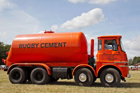 appears: POTTEN END, UK - JULY 27: A once often seen vintage cement mixer lorry appears in the main arena on display for the public to view at the Dacorum Steam fair on July 27, 2014 in Potten End Editorial