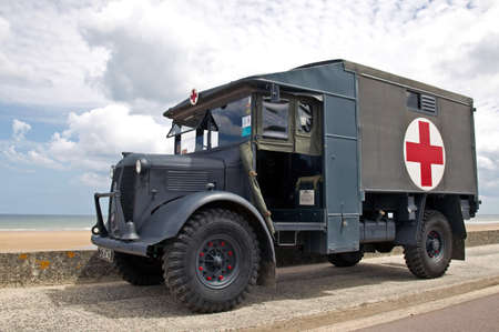 british army: VIERVILLE, FRANCE - JUNE 5: A vintage WW2 British army ambulance sits alongside Omaha beach in preparation for the 70th D-Day celebrations on June 5, 2014 in Vierville