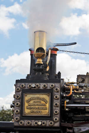 traction engine: POTTEN END, UK - JULY 27:  A large industrial showmans steam traction engine releases steam from an over pressure valve as a movement warning at the Dacorum Steam fair on July 27, 2014 in Potten End Editorial