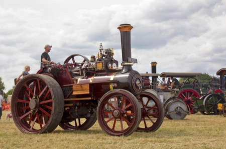 traction engine: POTTEN END, UK - JULY 27: A preserved steam traction engine gives a display to the public in the main show arena at the Dacorum Steam Fair on July 27, 2014 in Potten End