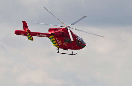 responded: LONDON - JUNE 14: The London Air Ambulance flies overhead on route to a call in the city on June 14, 2014 in London. The LAA was founded in 1989 and has responded to approximately 30,000 calls