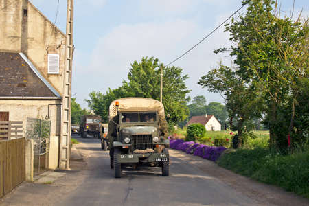 convoy: ETREHAM, FRANCE - MAY 30: WW2 military vehicles from the MVT drive in convoy towards the D-Day landing beaches of Normandy as part of the 70th Anniversary celebrations on May 30, 2014 in Etreham.