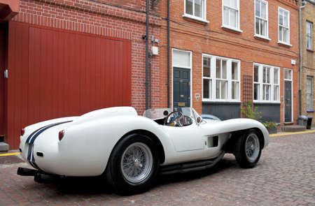enzo: LONDON - JULY 10: A Ferrari 250TR stands on static display in Adam & Eve Mews on July 10, 2014 in London. The company was founded in 1929 by Enzo Ferrari and employees around 2700 personnel