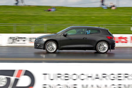 unnamed: PODINGTON, UK - APRIL 11: An unnamed driver of a modern VW Golf takes his car down the Santa Pod raceway as part of the RWYB competition during the Big Bang festival on April 11,2014 in Podington Editorial