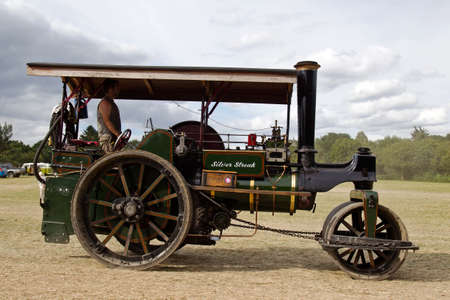 traction engine: POTTEN END, UK - JULY 27: A large vintage traction engine leaves the parade grounds heading toward the vehicle preparation area at the Dacorum Steam fair on July 27, 2014 in Potten End