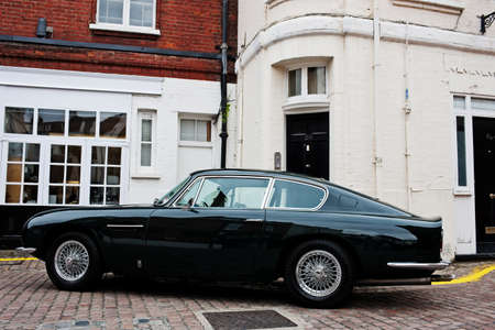 motorcars: LONDON - JULY 10: A vintage Aston Martin DB6 stands on static display in Adam & Eve Mews on July 10, 2014 in London. 1,967 DB6 motorcars were produced between 1965 - 1971 Editorial