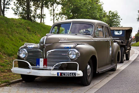 dodge: VIERVILLE-SUR-MER, FRANCE - JUNE 4: A WW2 Dodge staff car is parked alongside the road to Omaha beach during the 70th anniversary of the D-Day landing celebrations on June 4, 2014 in Vierville-sur-mer