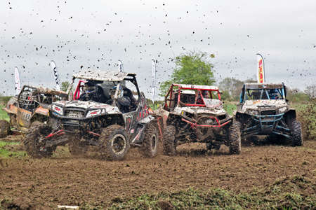 off road racing: HYDE, UK - APRIL 6: Drivers competing in the NoraSXS UK champs approach the first corner at speed causing a bottleneck for the following field during Rd 1 of the 2014 season on April 6, 2014 in Hyde