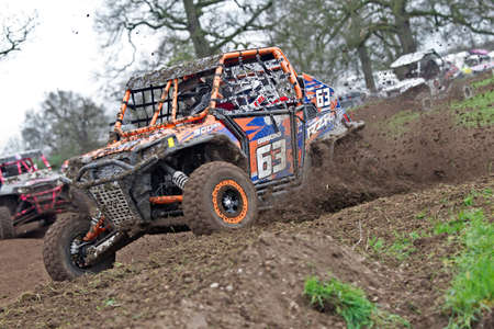 unnamed: HYDE, UK - APRIL 6: An unnamed driver leads his Polaris SXS vehicle around a tight corner at speed during Round 1 of the 2014 UK SXS championship on April 6, 2014 in Hyde