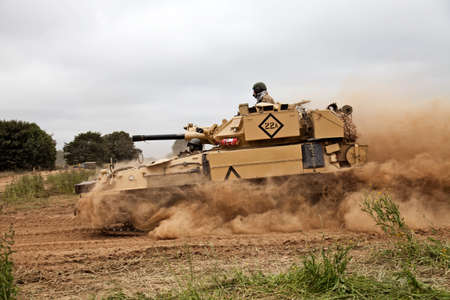 scimitar: WESTERNHANGER, UK - JULY 20: A vintage ex British army Scimitar tank gives a demonstration of its agility to the public at the War & Peace show on July 20, 2014 in Westernhanger
