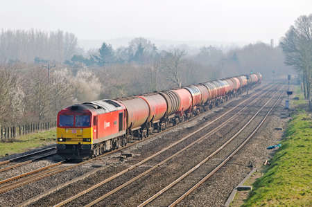 loco: CHOLSEY, UK - MARCH 14: A Murco petrol train heads through Oxfordshire on route to South Wales on March 14, 2014 in Cholsey. Murco is a petroleum refinery company setup in 1960 by Murphy Oil corp