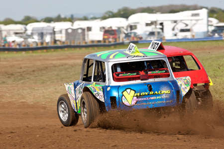 unnamed: STROUD, UK - MAY 3: Two unnamed drivers competing in Rd1 of the 2014 UKAC autograss series battle it out for first place as they exit the final corner of the heat on May 3, 2014 in Stroud