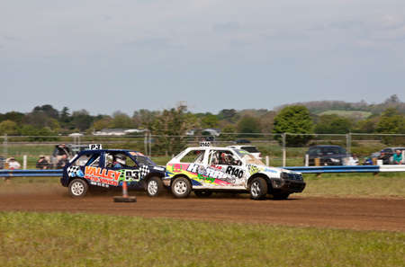 shunt: STROUD, UK - MAY 3: Two unnamed drivers competing in Rd1 of the 2014 UKAC autograss series come together in a rearend shunt in their class 2 vehicles as they enter corner one on May 3, 2014 in Stroud Editorial