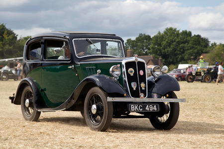 motorcar: POTTEN END, UK - JULY 27: A vintage Austin 8 motorcar leaves the main show arena after being displayed to the public at the Dacorum Steam & Country fair on July 27, 2014 in Potten End
