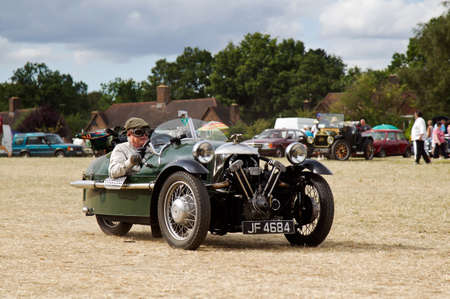 three wheeler: POTTEN END, UK - JULY 27: A 1933 Morgan supersport three wheeler leaves the show ground having given a display to the public at the Dacorum Steam & Country fair on July 27, 2014 in Potten End