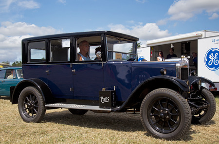 motorcar: POTTEN END, UK - JULY 27: A veteran Austin saloon automobile is paraded around the main arena for the public to view at the Dacorum Steam & Country fair on July 27, 2014 in Potten End