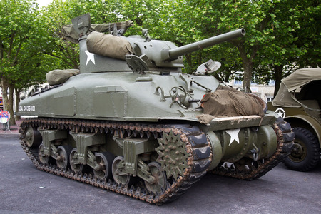 mere: ST MERE EGLISE, FRANCE - JUNE 3: A vintage WW2 allied army Sherman tank is put on public display in the town square as part of the 70th D-Day anniversary celebrations on June 3, 2014 in St Mere Eglise