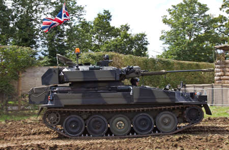 british army: HEADCORN, UK - AUGUST 16: An ex British army light Scorpian tank is driven around the main show arena at speed for the public to watch at the Combined Ops show on August 16, 2014 in Headcorn. Editorial