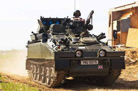 british army: WESTERNHANGER, UK - JULY 16: An ex British army Striker missile launcher displays its agility and mobility on the battlefield to the visiting public at the W&P show on July 16, 2014 in Westernhanger Editorial