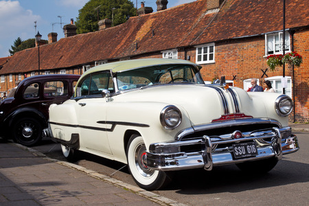 motorcar: AMERSHAM, UK - SEPTEMBER 7: A vintage and iconic American built Pontiac motorcar stands on public display at the annual Amersham Heritage Day show on September 7, 2014 in Amersham