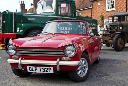 motorcar: AMERSHAM, UK - SEPTEMBER 7: A classic Triumph Herald motorcar stands on public display at the annual Amersham Heritage Day show on September 7, 2014 in Amersham