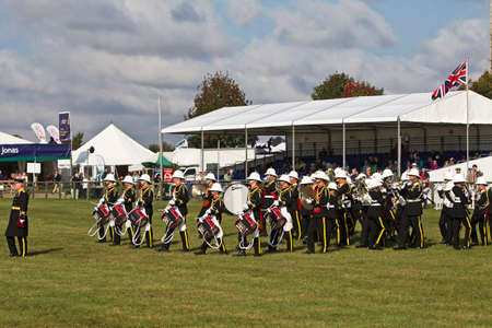 military watch: NEWBURY, UK - SEPTEMBER 21: A local military brass band open the days events with a selection of marching songs for the public to watch at the Berks County show on September 21, 2014 in Newbury Editorial