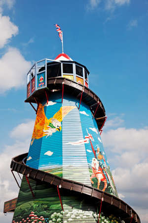 showground: NEWBURY, UK - SEPTEMBER 21: A helter skelter ride stands proudly at the centre of the fun fair area at the Berks showground for the public to take pleasure rides on, on September 21, 2014 in Newbury