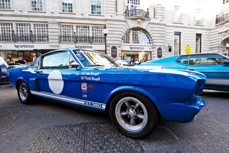 motorcar: LONDON - NOVEMBER 1: A classic Ford Mustang is parked at the bottom end of Regent Street on public display during the annual Regent street motor show on November 1, 2014.